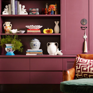 Inspiration for a mid-sized eclectic open concept medium tone wood floor and brown floor family room remodel in Sydney with purple walls and a media wall