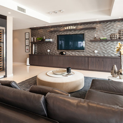 Inspiration for a large contemporary family room remodel in Miami with brown walls, no fireplace and a wall-mounted tv