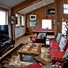 Rustic Family Room by DC Building