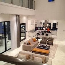 Modern Family Room by Zero Latitude