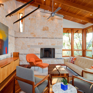 Example of a trendy family room design in Austin with beige walls, a standard fireplace and a stone fireplace