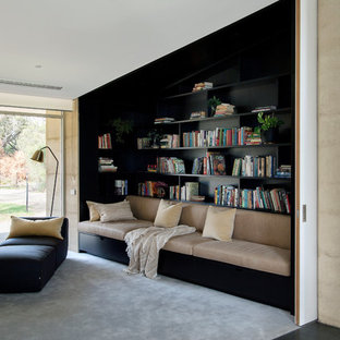 Design ideas for a contemporary enclosed family room in Perth with a library, carpet and grey floor.