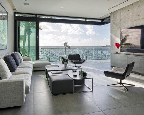 Example Of A Minimalist Open Concept Ceramic Floor And Gray Floor Family  Room Design In Miami