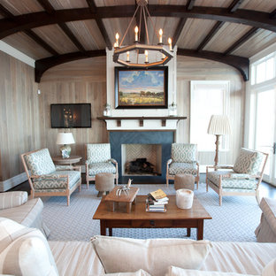 Inspiration for a beach style family room remodel in Raleigh with a standard fireplace