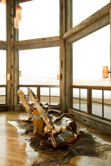 Rustic Family Room by Montana Reclaimed Lumber Co.