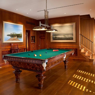 Example of a classic family room design in Tampa