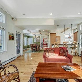 Idées déco pour une salle de séjour contemporaine de taille moyenne et ouverte avec un mur blanc, un sol en bois clair, une cheminée standard, un manteau de cheminée en pierre, télé d'angle et un sol jaune.