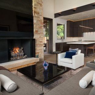 Medium sized rustic open plan family and games room in Denver with white walls, medium hardwood flooring, a standard fireplace, a metal fireplace surround and a wall mounted tv.