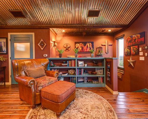 Soggiorno con libreria e pareti arancioni - Foto, Idee, Arredamento
