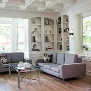 Inspiration for a large beach style medium tone wood floor and brown floor family room remodel in Los Angeles with a music area and white walls