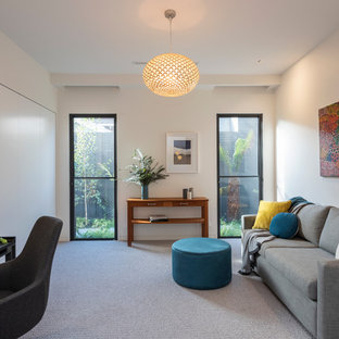 Design ideas for a contemporary enclosed family room in Melbourne with white walls, carpet and grey floor.