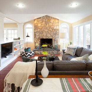 Family room - traditional family room idea in New York with beige walls and a standard fireplace