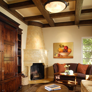 Inspiration for a mediterranean family room remodel in Los Angeles with a corner fireplace