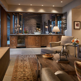 Bifold windows over an indoor-outdoor bar open up this family room to the patio