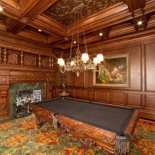 ニューヨークの大きいトラディショナルスタイルのおしゃれな独立型ファミリールーム (ゲームルーム、茶色い壁、カーペット敷き、標準型暖炉、石材の暖炉まわり、テレビなし) の写真