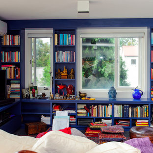 Mid-sized eclectic open concept family room in Sydney with a library, carpet, a freestanding tv and blue walls.