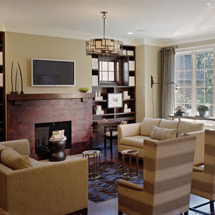 Inspiration for a timeless family room remodel in Detroit with beige walls, a standard fireplace and a wall-mounted tv