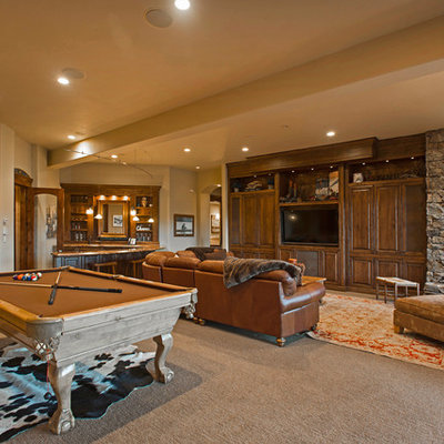 Inspiration for a rustic open concept carpeted and beige floor family room remodel in Salt Lake City with beige walls and a wall-mounted tv