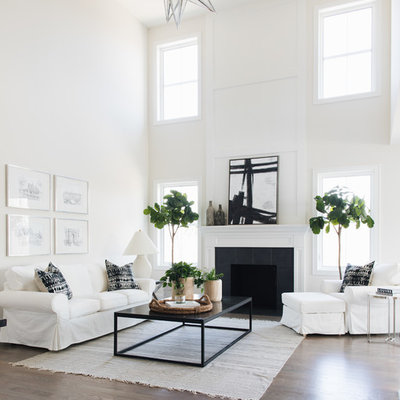 Transitional open concept family room photo in Chicago with white walls, a standard fireplace and a tile fireplace