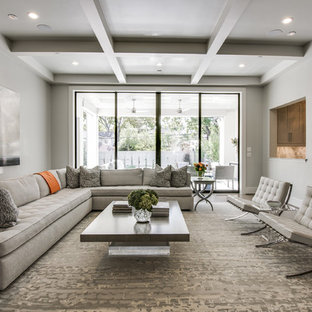 Mid-sized transitional enclosed dark wood floor and brown floor family room photo in Dallas with gray walls, a standard fireplace, a concrete fireplace and a wall-mounted tv