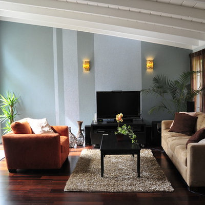Example of a trendy dark wood floor family room design in San Francisco with blue walls