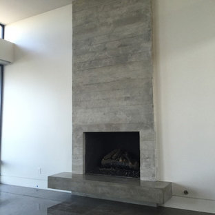 Example of a mid-sized minimalist open concept family room design in Orange County with white walls and a standard fireplace