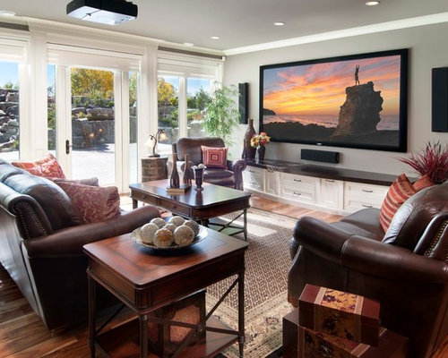 Mid Sized Elegant Medium Tone Wood Floor Family Room Photo In Calgary With Gray Walls