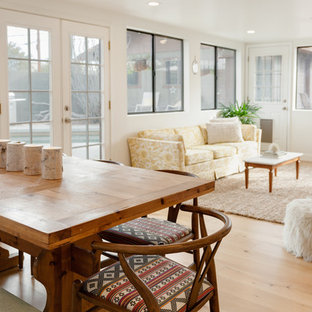 Mid-sized eclectic open concept family room in Phoenix with white walls and light hardwood floors.