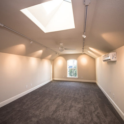 Large arts and crafts loft-style carpeted family room photo in Austin with beige walls