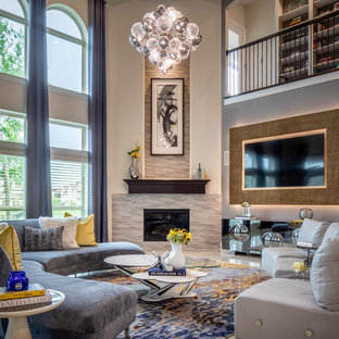 Huge transitional open concept porcelain tile and beige floor family room photo in Houston with gray walls, a corner fireplace, a tile fireplace and a wall-mounted tv
