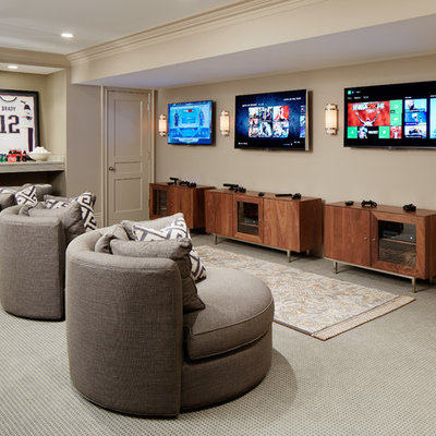 Example of a large transitional carpeted and gray floor family room design in Chicago with beige walls and no fireplace