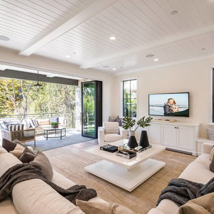 Family room - transitional open concept dark wood floor and brown floor family room idea in Los Angeles with beige walls