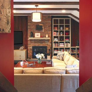 Example of a mid-sized transitional enclosed dark wood floor family room design in New York with red walls, a standard fireplace, a brick fireplace and a wall-mounted tv