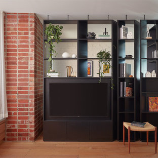 Inspiration for a scandinavian family room in Melbourne with a library, light hardwood floors and a built-in media wall.