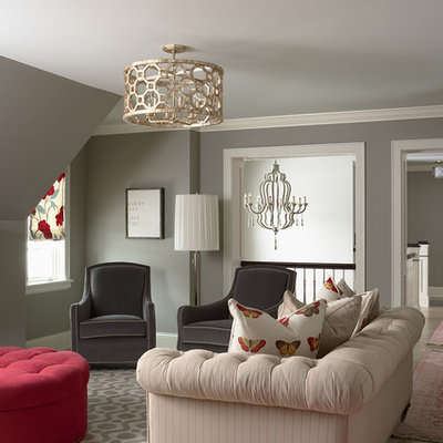 Example of a classic medium tone wood floor family room design in Minneapolis with gray walls