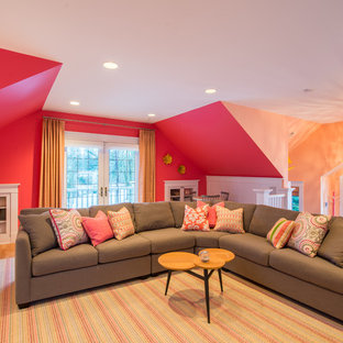 Family room - eclectic loft-style family room idea in Seattle with pink walls