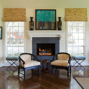 Elegant dark wood floor family room photo in Houston with beige walls, a standard fireplace and a tile fireplace