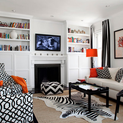 Family room library - mid-sized contemporary open concept dark wood floor and brown floor family room library idea in San Francisco with white walls, a standard fireplace, a wall-mounted tv and a wood fireplace surround