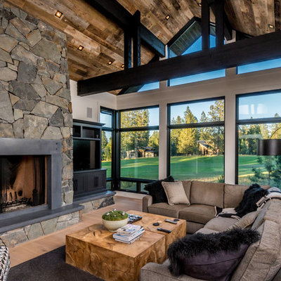 Inspiration for a rustic light wood floor family room remodel in Other with white walls, a standard fireplace, a metal fireplace and a media wall