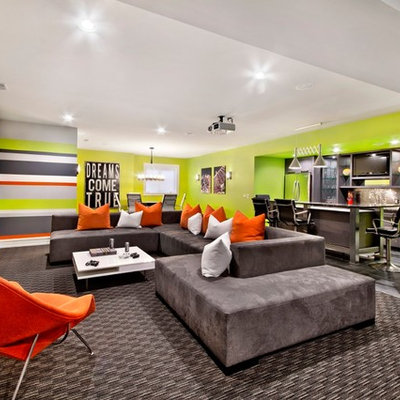 Inspiration for a mid-sized contemporary open concept carpeted family room remodel in Detroit with multicolored walls, a bar, no fireplace and a wall-mounted tv