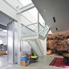 Industrial Family Room by BWArchitects (formerly Basil Walter Architects)