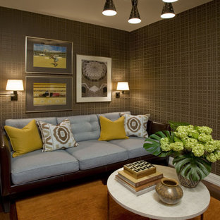 Example of an eclectic enclosed family room design in New York with brown walls