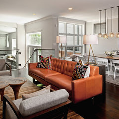 eclectic family room by Buckingham Interiors + Design LLC