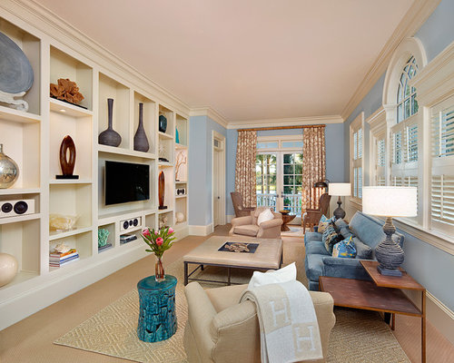 Traditional Enclosed Carpeted Family Room Idea In Charleston With Blue Walls  And A Media Wall
