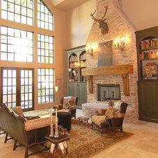 Mediterranean Family Room by R.S. Stapleton Company - Custom Cabinetry