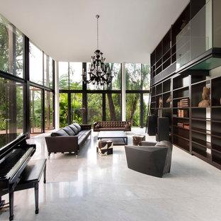 Immagine di un soggiorno contemporaneo aperto con sala della musica, pavimento in marmo e nessuna TV