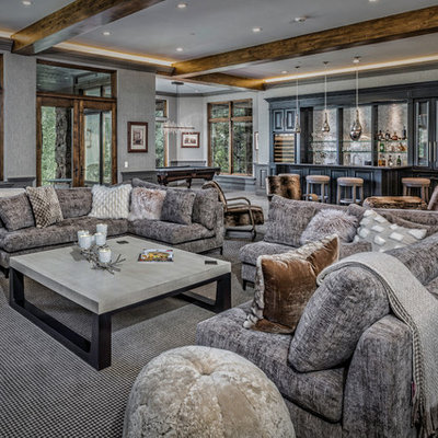 Example of a large mountain style open concept carpeted and gray floor family room design in Denver with a bar, gray walls, no fireplace and no tv