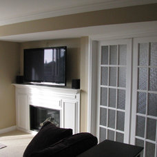 Traditional Family Room by HARDROCK CONSTRUCTION