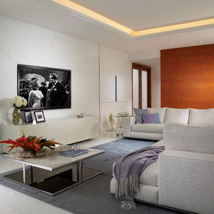 Family room - large contemporary open concept marble floor and white floor family room idea in Miami with white walls and a media wall