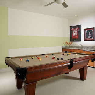 Game room - mid-sized contemporary open concept marble floor and white floor game room idea in Miami with multicolored walls